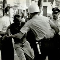 Atlanta Race Relations, African American Man Arrested by Police and Plain Clothesman during Capitol Avenue Riot,